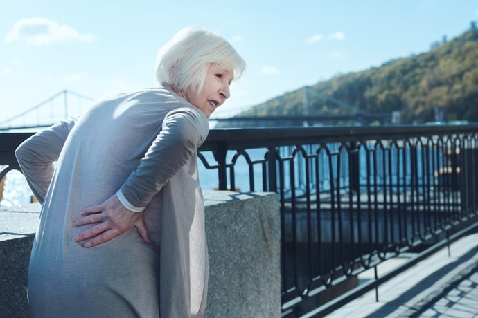 why do i get lower back pain when walking or standing for long periods