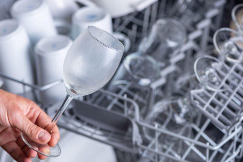 Dishwasher leaving gritty residue on top rack