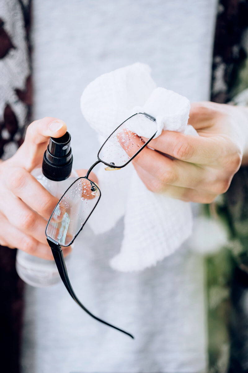 How to remove a cloudy film from eyeglasses with eyeglass cleaner?