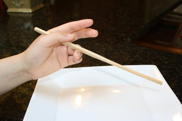 How to use chopsticks to eat?